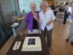 Michelle Cavanagh & Brigitte Lucey propose a toast before cutting the cake